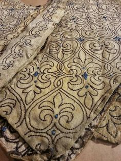 17th century embroidery at the Royal Armoury in Sweden. A never finished jacket in chamois leather, embroidered with brown silk and unspun blue silk. (A men's jacket that was meant for Gustaf II Adolf?)