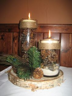 Centerpieces were a large birch slab with two cylinder vases with sand river roc. Centerpieces were a large birch slab with two cylinder vases with sand river rock pinecones and candle with twine around. Wedding Table Centerpieces, Wedding Flower Arrangements, Christmas Centerpieces, Christmas Decorations, Holiday Decor, Pinecone Wedding Decorations, Antler Wedding Decor, Wedding Ideas, Wedding Tables