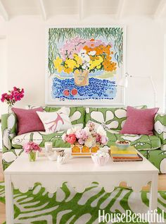 "Vibrant colors, a mix of patterns, and flowers everywhere — real, painted, and printed on the sofa's Clover Poppy, from Hable Construction — make the living room ""cheerful, bright and playful,"" says designer Krista Ewart.   - HouseBeautiful.com"