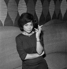 "Eartha Mae Kitt (January 17, 1927 – December 25, 2008) was an American singer, actress, dancer and cabaret star. She was perhaps best known for her highly distinctive singing style and her 1953 hit recordings of ""C'est Si Bon"" and the enduring Christmas novelty smash ""Santa Baby"". Orson Welles once called her the ""most exciting woman in the world"""