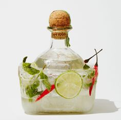 Freeze a Bottle of Liquor, Be the Coolest Host Ever | Bon Appetit - Ice-encased tequila with limes, mint and chiles