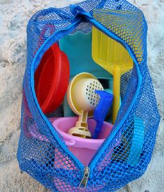 Sand toys!  And the separate mesh bag doesn't hurt either.  It lets the sand fall through and out, rather than trapping it inside.