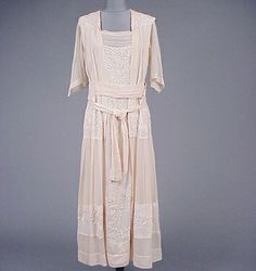 Pink Wisteria Embroidered Gown  Attributed to Liberty & Company  1910s   Chiffon, pleated from shoulder yoke to waist, and again from hip yoke to hem, middy style bodice with square collar at back, obi influenced self belt at natural waist, tying at front, the embroidery worked at shoulder, belt, hip yoke, center front skirt and band at skirt bottom, two underslips