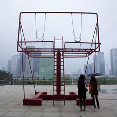 Architect Didier Fiuza Faustino of Paris studio Mésarchitectures has installed a pair of swing seats on a billboard frame as part of the Shenzhen & Hong Kong bi-city Biennale of Urbanism/Architecture in China this week.