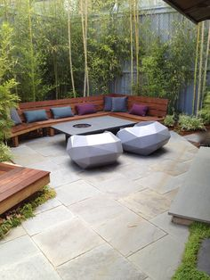 Bamboo, bench and slate firepit // Sculpt Gardens