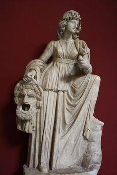A 1st century CE Roman sculpture of Melpomene, the Muse of tragedy. She holds a sword and the tragic mask of Hercules. (Vatican Museums, Rome).