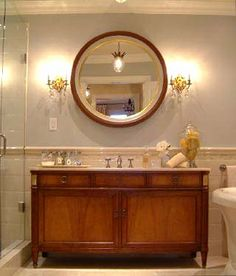Sarah Richardson's Design Inc bathroom. That is an antique sideboard they converted to a double sink