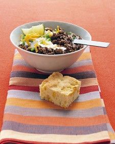 Bacon adds smoky flavor to this authentic Southwestern beef chili. Masa harina, or fine cornmeal, helps thicken it. Serve the lime wedges on the side.