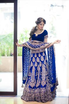 In a royal blue Manish Malhotra lehenga and an exquisite kundan neck-piece