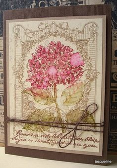 I love using distress inks. Flick water from a paintbrush onto distressed flower