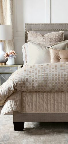 Subdued neutrals and simple designs are glamorizing. Gold accent pillows and sheen, ivory shams combine to coordinate with a yarn-dyed jacquard duvet cover in a deluxe champagne hue. #bedding #luxurybedding #designerbedding #bedroomideas #decoratingideas #masterbedroom #duvetcovers #comforters #luxe #glamorous