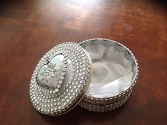 #diy #blingbling #jewelry box, made out of a repurposed can of Nivea daycream :-) inside of the can is covered with satin.
