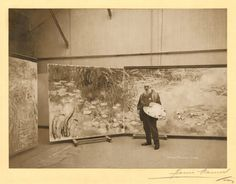 Monet in front of his paintings in his studios, 1920