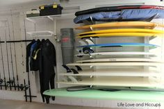 Howards Storage World Garage Makeover includes elfa system, tubtrugs and fishing rod holders. Surfboard Storage, Surfboard Rack, Skateboard Rack, Garage Organization, Garage Storage, Workshop Organization, Storage Area, Storage Room, Howard Storage