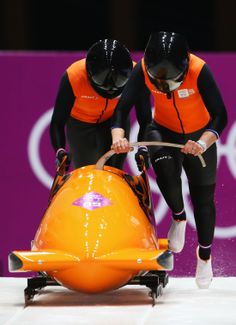 Esme Kamphuis and Judith Vis of the Netherlands team 1 make a run during the Women's Bobsleigh heats (c) Getty Images Bobsleigh, Olympic Games, Netherlands, Olympics, Motorcycle Jacket, Athlete, Running, Sports, Sport