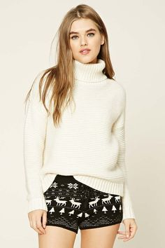 A pair of ribbed knit shorts featuring a Fair Isle pattern, an elasticized waist with a self-tie bow, and ribbed trim.