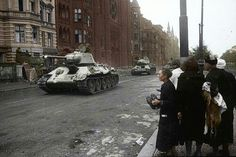 T-34 in Berlin. the first carries a 76.2mm gun, while the second is a late model upgraded to 85mm.