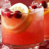 Cranberry-Pineapple Cooler Recipe 1/2 cupsugar,1/2 cupwater, 2   cups cranberry juice, chilled, 1   cup orange juice, chilled, 1 cup unsweetened pineapple juice, chilled  3/4 cup lemon juice, chilled, 2 liter bottle ginger ale, chilled, ice cubes  Fresh cranberries (optional) Lemon slices (optional)