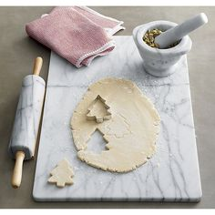 Shop French Kitchen Marble Pastry Slab. A substantial slab of white marble with unique grey veining is a sophisticated kitchen addition for the home baker. Marble slab remains cooler than room temperature, helping keep dough firm while you roll and cut.