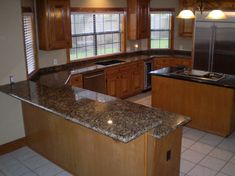 The Granite Gurus: Slab Sunday: Giallo Portofino granite. With this type of set up we could open up the wall the stove is on. Kitchen Cabinet Storage, Update Cabinets, Kitchen Cabinets And Countertops, Tile Installation, Kitchen Countertops, Kitchen Cupboards, Kitchen, Granite Countertops Price