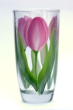 Deep pink and cream tulips with white highlights and deep green flowing leaves hand-painted encircling a quality 15.8 ounce tumbler glass.