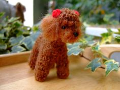 wool felted poodle with red bows