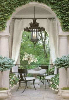 Outdoor dining room. The stone table surrounded by klismos chairs and that unbelievable lantern. This house, designed by Bobby McAlpine, was featured in Veranda years ago, and this picture made the cover of the new book Veranda: The Art of Outdoor Living.