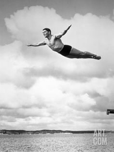 1930s Man Swan Diving from High Diving Board Outdoor Photographic Print at Art.com