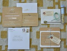 The details are amazing in this kraft paper wedding invitation suite! Love the use of gold foil swiss dot paper, mint & white bakers twine, and vintage tag.