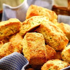 These chive-flecked cornmeal biscuits taste best made with extra-sharp Cheddar, but any type of Cheddar will work.