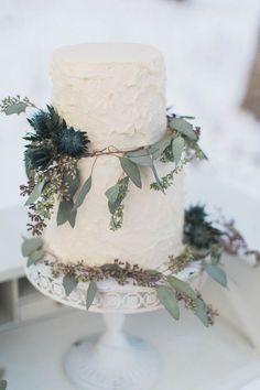 Simple white buttercream cake with eucalyptus greens
