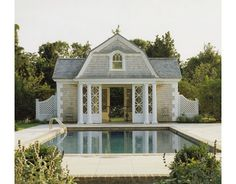 Follow your home's architecture. Your pool house doesn't have to match your home exactly, but it shouldn't look as though it's landed in the wrong yard, either. Be sure its style, lines and proportions complement those of the main house for visual cohesion.