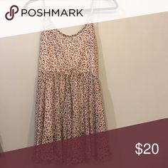 Brandy Melville floral dress Brandy Melville floral dress. Very cute! One strap ripped and is knotted to hold together but it's still very wearable Brandy Melville Dresses