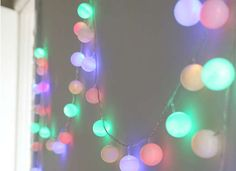 Add ping pong balls over colored Christmas lights for a year round look and feel