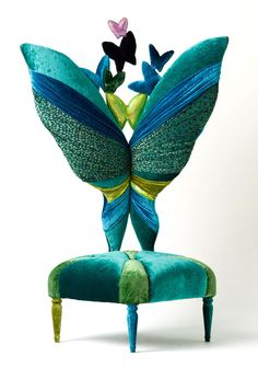 "GORGEOUS CHAIR  ""Miss Butterfly"" references the emerald color, while Its curves follow a similar wave to those in the necklace. A special royal dons the emerald necklace and lights on a beautiful butterfly--what a lovely ephemeral illusion."