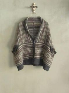 Inspiration - looks like 2 rectangles with armholes left open and finished in contrast yarn.