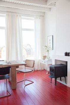 Red floor in a Dutch guest house with red floors and vintage touches. Holly Marder.