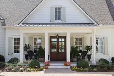 classic farmhouse painted Sherwin Williams Dover White; shutters are SW Ancient Marble