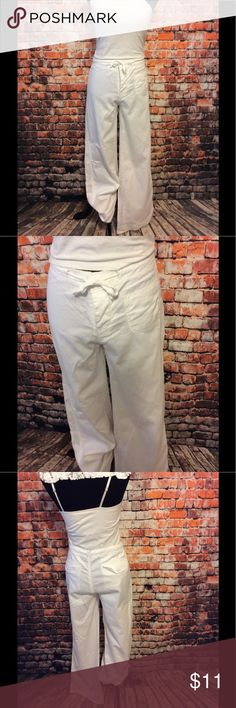 "American Outpost white 100% cotton pants size 10 American Outpost white 100% cotton pants size 10-3 buttons & closure approx 17% waist -approx 9"" rise-approx 41"" length -30.5"" inseam -approx 19"" hip -happy to answer questions-fast shipper American Outpost Pants"