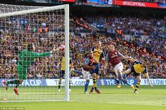 Veteran goalkeeper Shay Given (left) makes a stunning save from Laurent Koscielny's powerf...