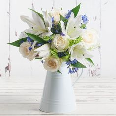 This purely stunning bouquet is the perfect way to send your best wishes on any occasion. White oriental lilies, avalanche roses, blue agapanthus and green bell make for a fantastic combination. Valentines Flowers, Valentines Day, Oriental Lily, Agapanthus, Flowers Delivered, Red Roses, Bouquet, Sky, Make It Yourself