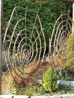 Giant spider webs for the garden; make a metal spider to hang on them.