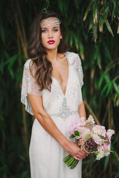 I have to admit this reminds some what of a Gatsby meets modern touch. It just so well put together however I would prefer much darker lips but that's just me. Gown designer unknown but if you have any information please let me know.(028)-Lottie.B