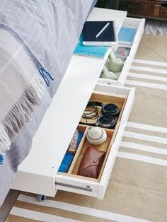 You can split up the valuable space under your mattress equally by assigning a different drawer to you and your partner (and throwing in a few organizers so they don't become His and Hers junk drawers). Click through for this and more under-bed organization ideas.
