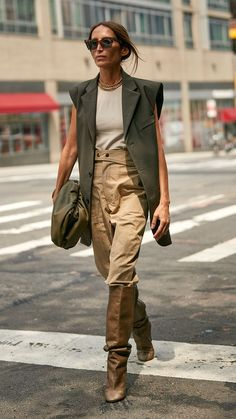 New York Fashion Week Street Style Trends Loulou De Saison in Waistcoat an. New York Fashion Week Street Style Trends Loulou De Saison in Waistcoat and Trousers Tucked into Knee High Boots Street Style Trends, New Street Style, New York Fashion Week Street Style, Looks Street Style, Street Style Women, High Fashion Style, Street Fashion Nyc, New York Style, Uk Fashion