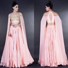 Love the unique cape sleeves on this pretty pink lengha by… Indian Wedding Outfits, Bridal Outfits, Indian Outfits, Indian Fashion Dresses, Indian Gowns Dresses, New Designer Dresses, Indian Designer Outfits, Choli Designs, Lehenga Designs