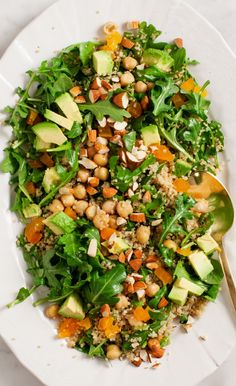 Quinoa salad with avocado, apricots, almonds & a lemony vinaigrette. Vegan & Gluten Free.