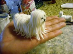 Small dog, I tried to make it look like a ShihTzu but Ithink it looks more like a sheep dog! Oh well!. Body is made from 2 marshmallows and head it 1/4 of a marshmallow. Hair is gumpast/fondant mix. Thanks for looking!