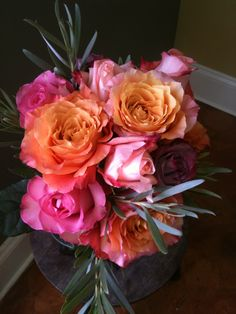 Vibrant rose bouquet with tropical lucadendron accompanying. #warm bouquet. #tropical feel florals