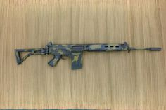 FAL 50.61 para with Rhodesian camo pattern.